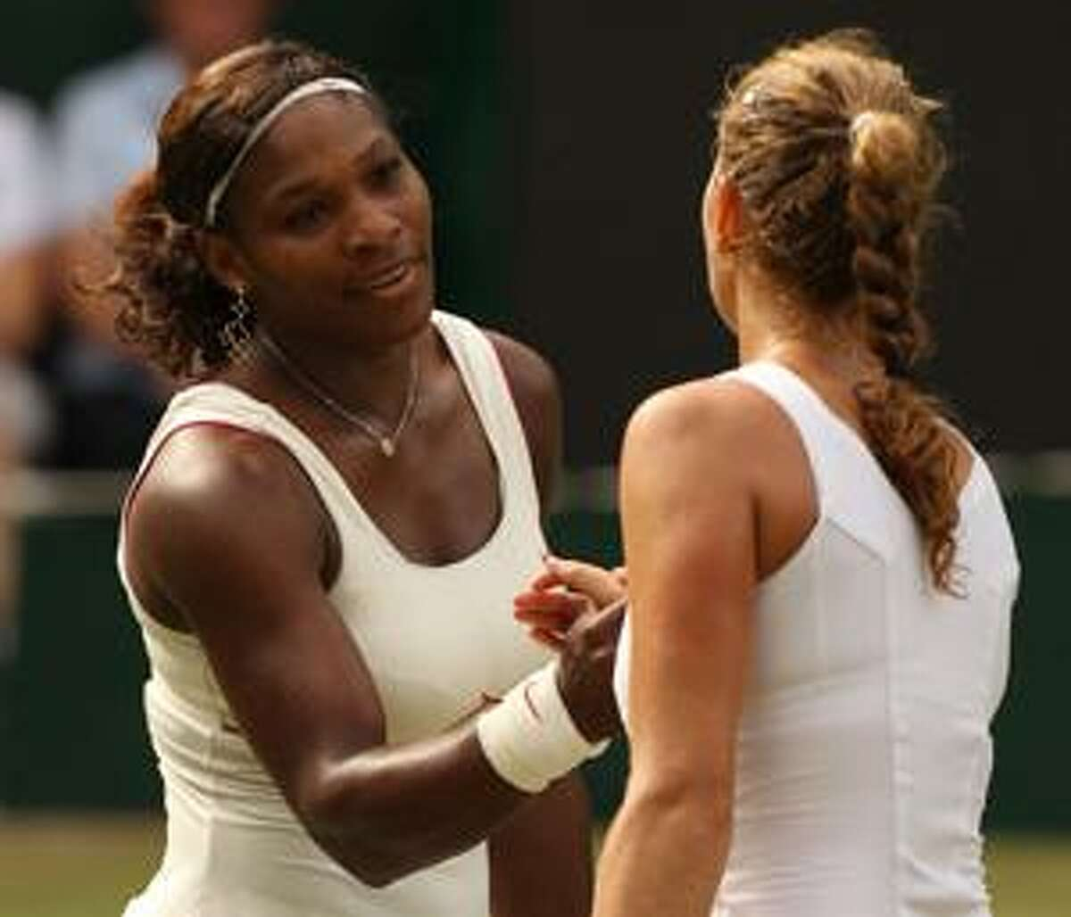 Serena Williams shakes hands with Petra Kvitova of the Czech Republic, after defeating her in their women's singles semifinal on the Centre Court at the All England Lawn Tennis Championships at Wimbledon, Thursday. (AP Photo/Jon Super)