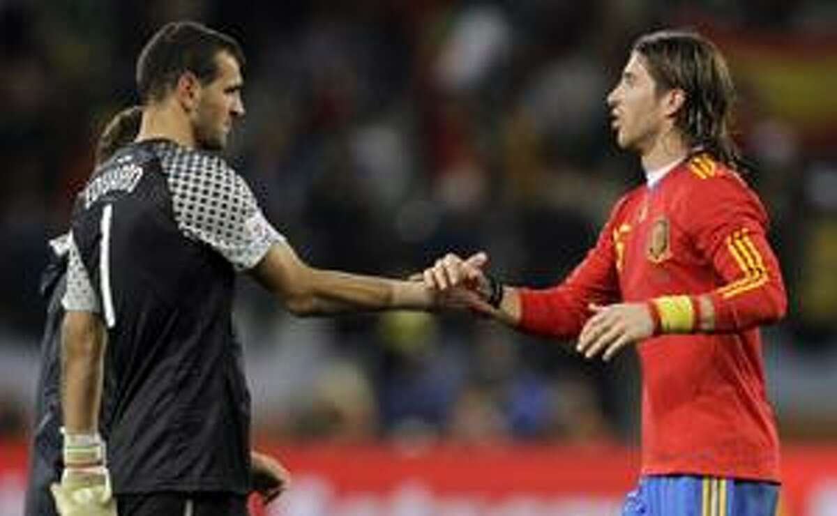 AP Portugal goalkeeper Eduardo, left, congratulates Spain's Sergio Ramos at the end of the World Cup round of 16 soccer match between Spain and Portugal at the Green Point stadium in Cape Town, South Africa, Tuesday. Spain won 1-0.