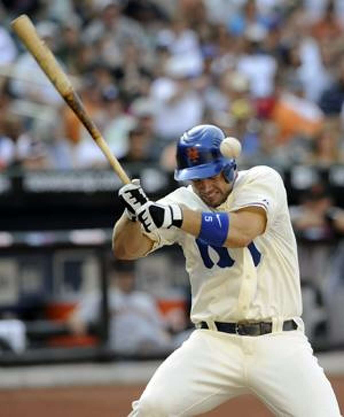 New York Mets' David Wright is hit with a pitch during the fourth inning of a game against the San Francisco Giants, Saturday in New York. (AP Photo/Newsday, David Pokress)
