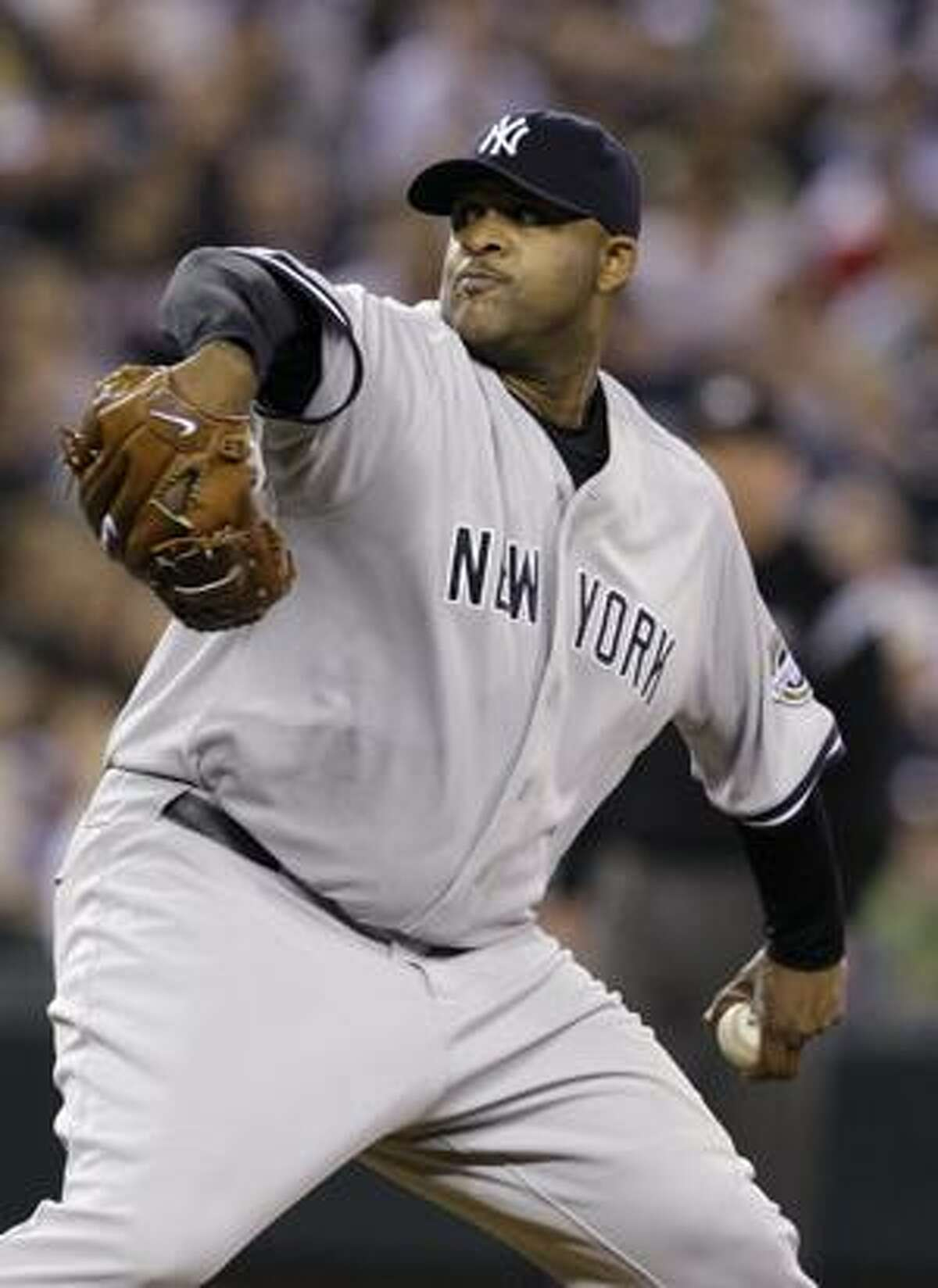 AP New York Yankees starting pitcher CC Sabathia throws a pitch against the Seattle Mariners in the second inning of an Aug. 13 game.