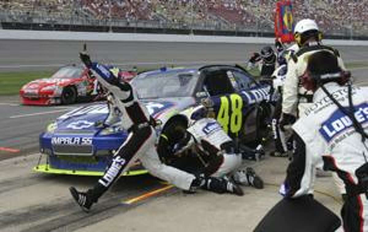 AP Jimmie Johnson makes a pit stop during the NASCAR Carfax 400 auto race at Michigan International Speedway in Brooklyn, Mich., Sunday.