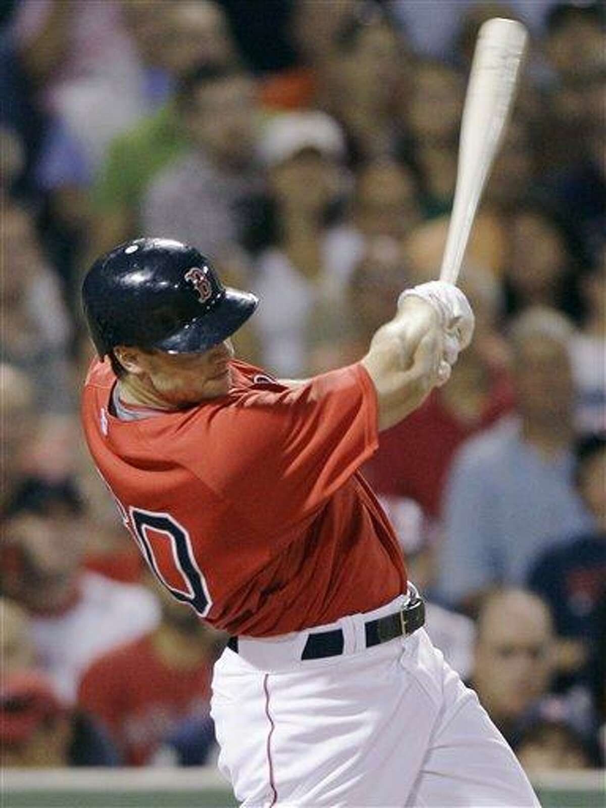 Boston Red Sox pinch hitter Daniel Nava follows through on his RBI single, breaking a 2-2 tie, against the Baltimore Orioles during the eighth inning of their baseball game at Fenway Park in Boston, Friday, July 2, 2010.(AP Photo/Charles Krupa)