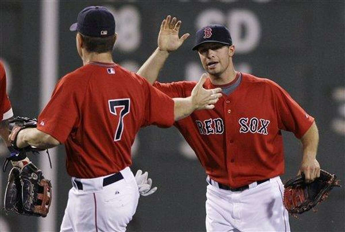 Boston Red Sox center fielder Daniel Nava, right, and right fielder J.D. Drew celebrate a 3-2 win over the Baltimore Orioles in their baseball game at Fenway Park in Boston, Friday, July 2, 2010. Drew had two solo home runs and Nava had an RBI single, which broke a 2-2 tie, in the Red Sox win.(AP Photo/Charles Krupa)