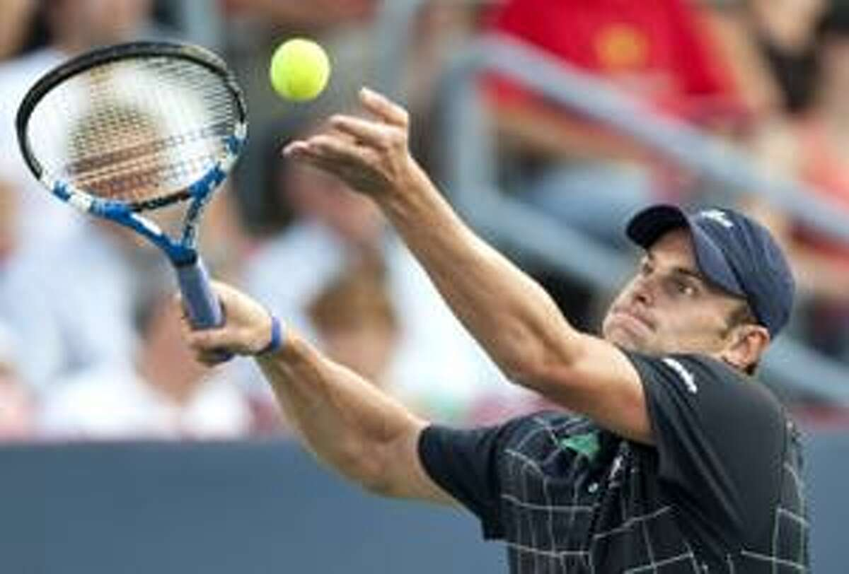 AP Andy Roddick serves to Juan Martin Del Potro, from Argentina, during semifinal play at the Rogers Cup tennis tournament Saturday in Montreal.