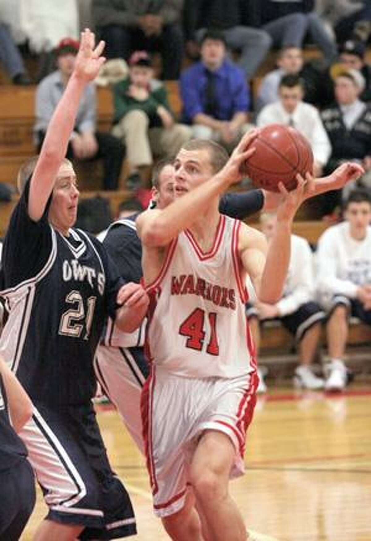 Wolcott Tech's Lance Pepper, left, tries to block a pass by Wamogo's Mike Odenwaelder Monday night in Litchfield.