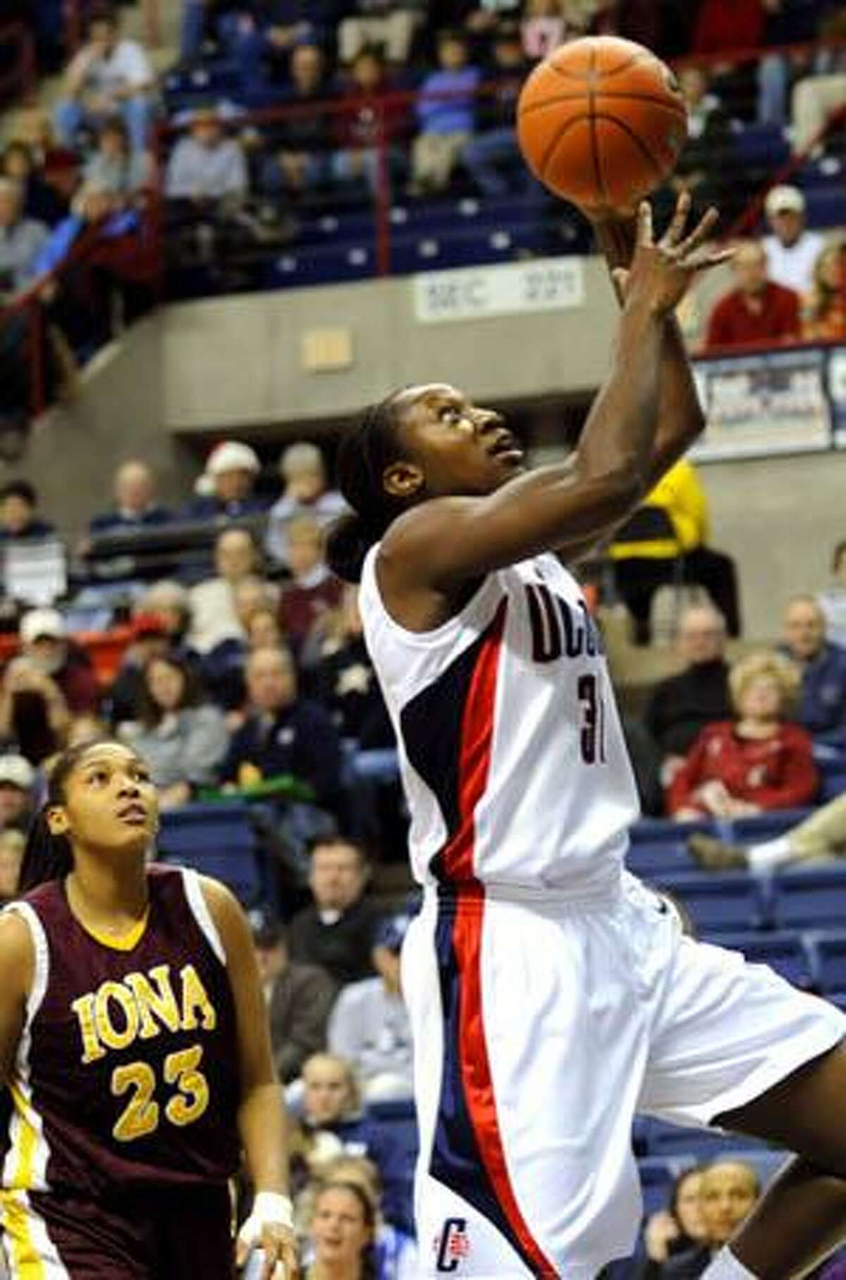 Connecticut's Tina Charles shoots as Iona's Kristina Ford looks on during the first half Sunday in Storrs.
