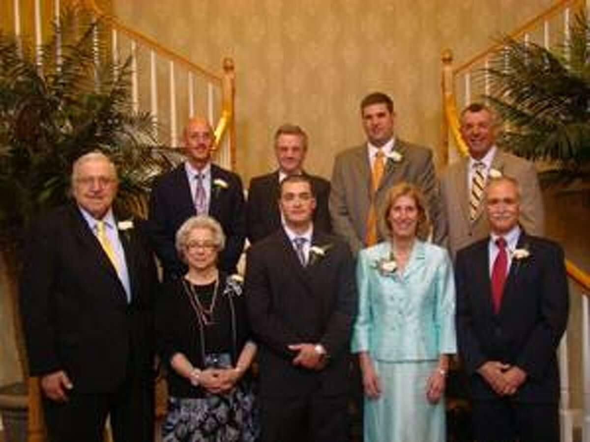 TIMOTHY W. GAFFNEY/Register Citizen correspondent The 14th class of the Torrington High School Hall of Fame. Front row (from left to right): Frank J. McGowan; Pat Colangelo (wife of Vito 'Billy' Colangelo); Nicholas Carbone; Carolyne Gatesy; Jack Gatesy. Second Row: Gerald Traub; Raymond 'Brooklyn' Colangelo; Michael C. Fritch; Michael J. Fritch. Not pictured: Joe Haberl.