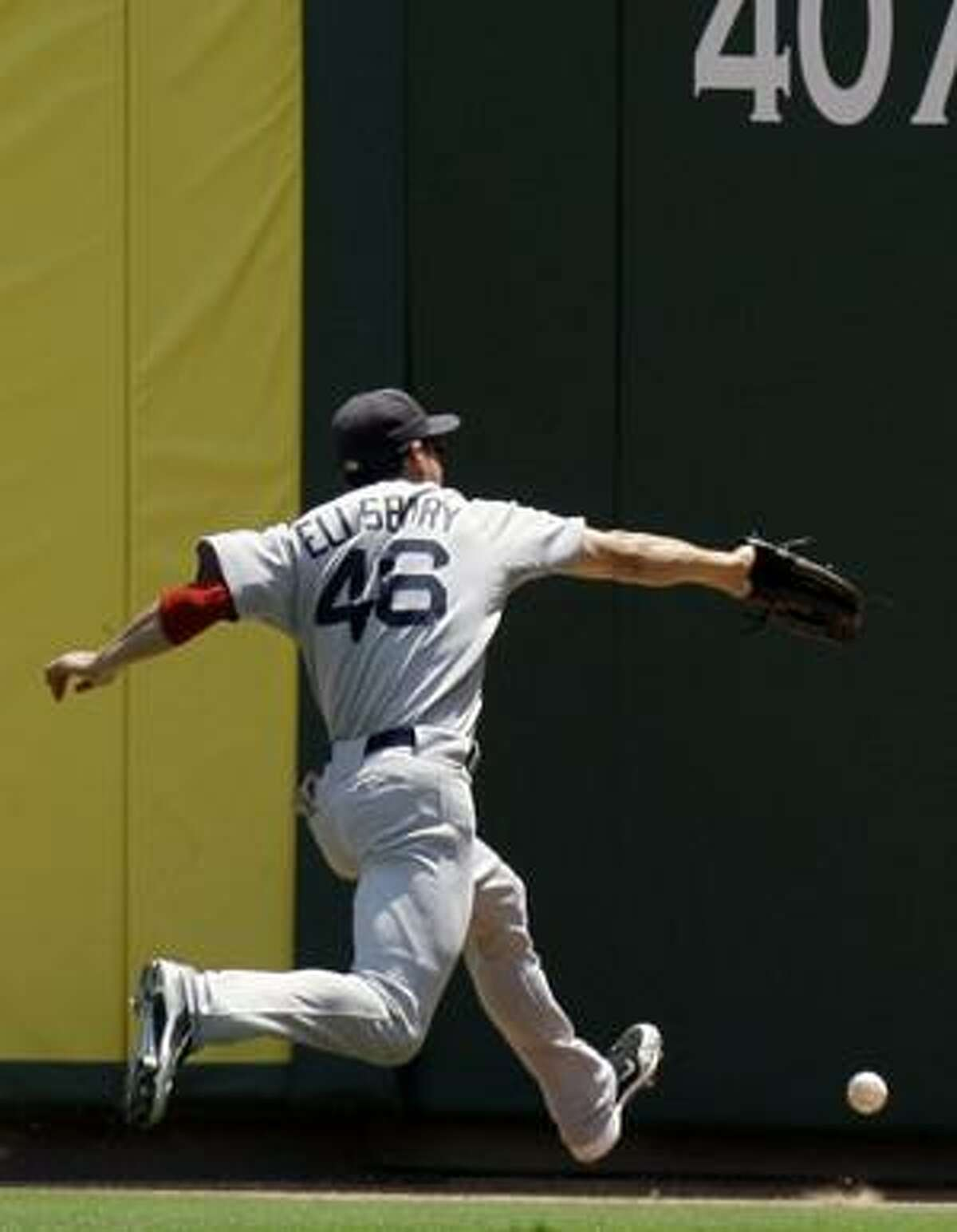 AP Boston Red Sox center fielder Jacoby Ellsbury (46) cannot catch a double by Texas Rangers' Elvis Andrus during the second inning Sunday in Arlington, Texas. The Rangers won 4-3.
