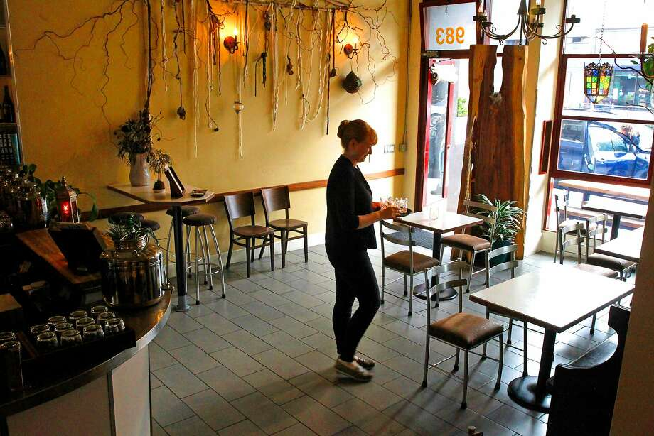 Hospitality manager Jenna Kitchell prepares for the evening opening at Duna in S.F. Photo: Michael Macor, The Chronicle