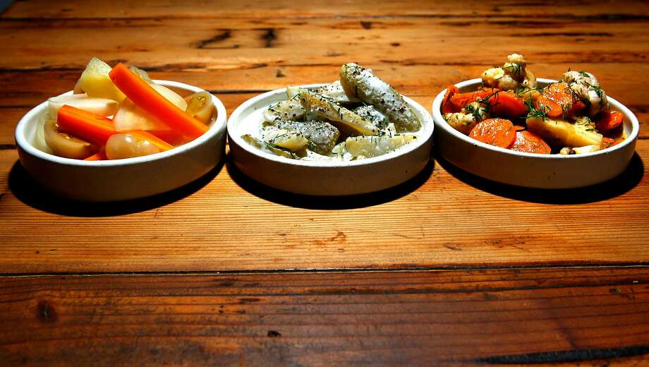 Brine pickles (left), cucumbers with sour cream, and mixed lime pickles at Duna in S.F. Photo: Michael Macor, The Chronicle