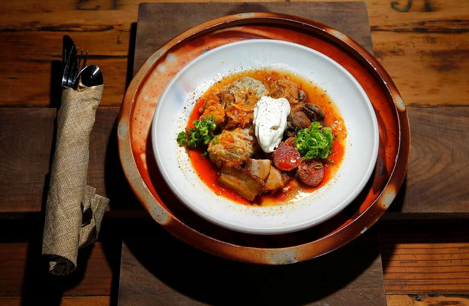 Stuffed cabbage with paprika sausage, pork belly, mushrooms, prunes and sour cream at Duna in S.F. Photo: Michael Macor, The Chronicle