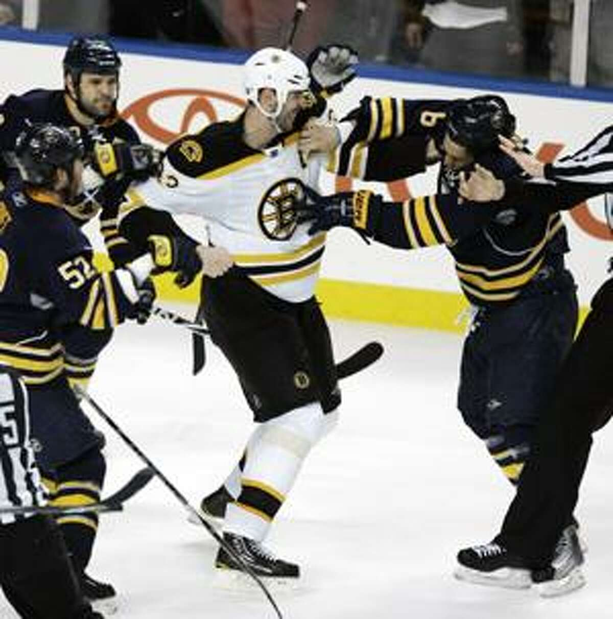 AP Buffalo's Cody McCormick, right, fights with Boston's Zdeno Chara (33)during the third period of a first-round NHL playoff game in Buffalo, N.Y., Friday. The Sabres won 4-1 to force Game 6 in the series.