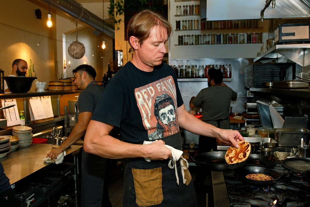 Chef Nick Balla at Duna, a Central-European restaurant in the Mission neighborhood as seen on Thurs. August 24, 2017, in San Francisco, Ca., prepares hand made flat bread.