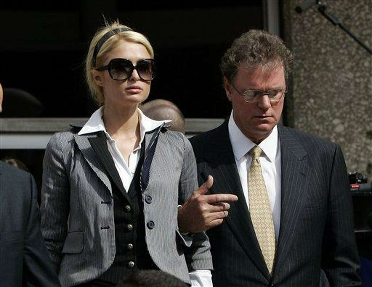 FILE - In this May 4, 2007 file photo, heiress Paris Hilton leaves the Los Angeles Municipal Court Metropolitan branch with her father Rick in Los Angeles. Hilton's lawyers have taken the first step to appeal her 45-day jail sentence after she was ordered by a judge to report to a county jail for violating the terms of her probation in an alcohol-related reckless driving case. Hilton appeared in a South African courtroom on Friday, July 2, 2010 after being arrested on suspicion possession of marijuana. (AP Photo/Damian Dovarganes, file)