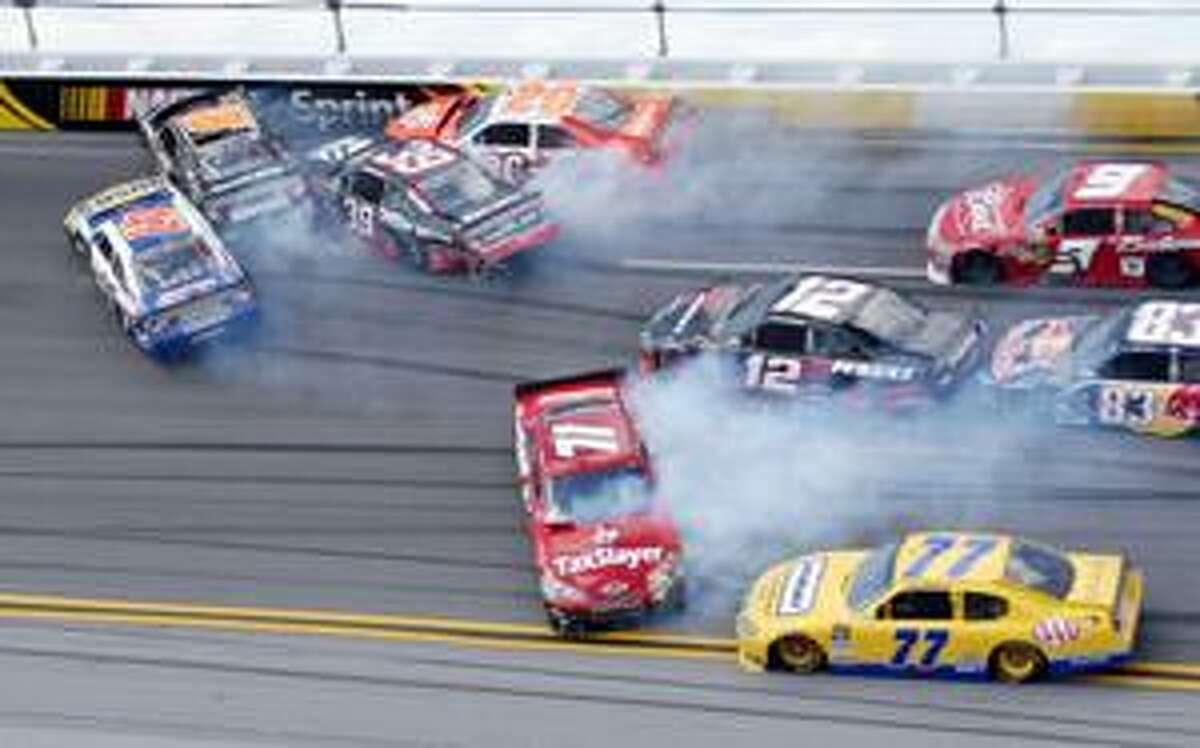 AP Marcos Ambrose (47), Elliott Sadler (19), Ryan Newman (39), Joey Logano (20), Bobby Labonte (71), Brad Kewselowski (12), Sam Hornish Jr. (77), Kasey Kahne (9) and Brian Vickers (83) crash during the NASCAR Sprint Cup Series Aaron's 499 auto race at Talladega Superspeedway in Talladega, Ala., Sunday.