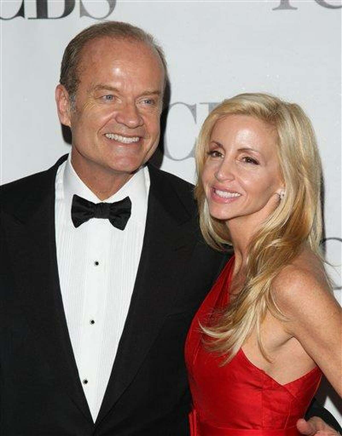 FILE - In this June 13, 2010 file photo, Kelsey Grammer and his wife Camille Grammer arrive at the 61st Annual Tony Awards in New York. (AP Photo/Peter Kramer, file)