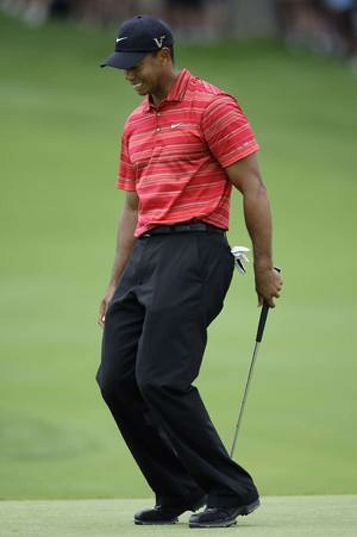 AP Tiger Woods reacts after missing an eagle putt on the 11th green during the final round of the 91st PGA Championship at the Hazeltine National Golf Club in Chaska, Minn., Sunday.