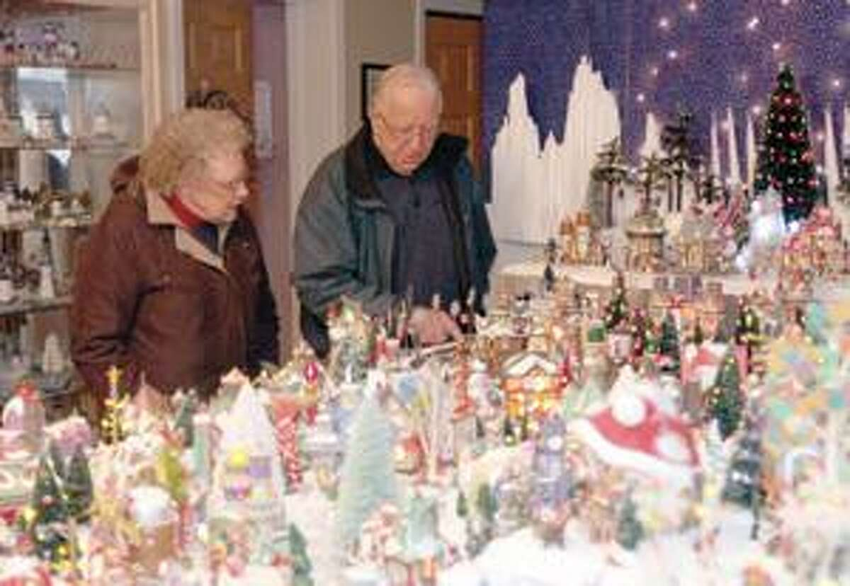 SONJA ZINKE/Register CitizenMarcia and Frank Gauthier of Torrington admire the winter wonderland set up in the home of the Millers in New Hartford Saturday. Purchase a glossy print of this photo and more at www.registercitizen.com