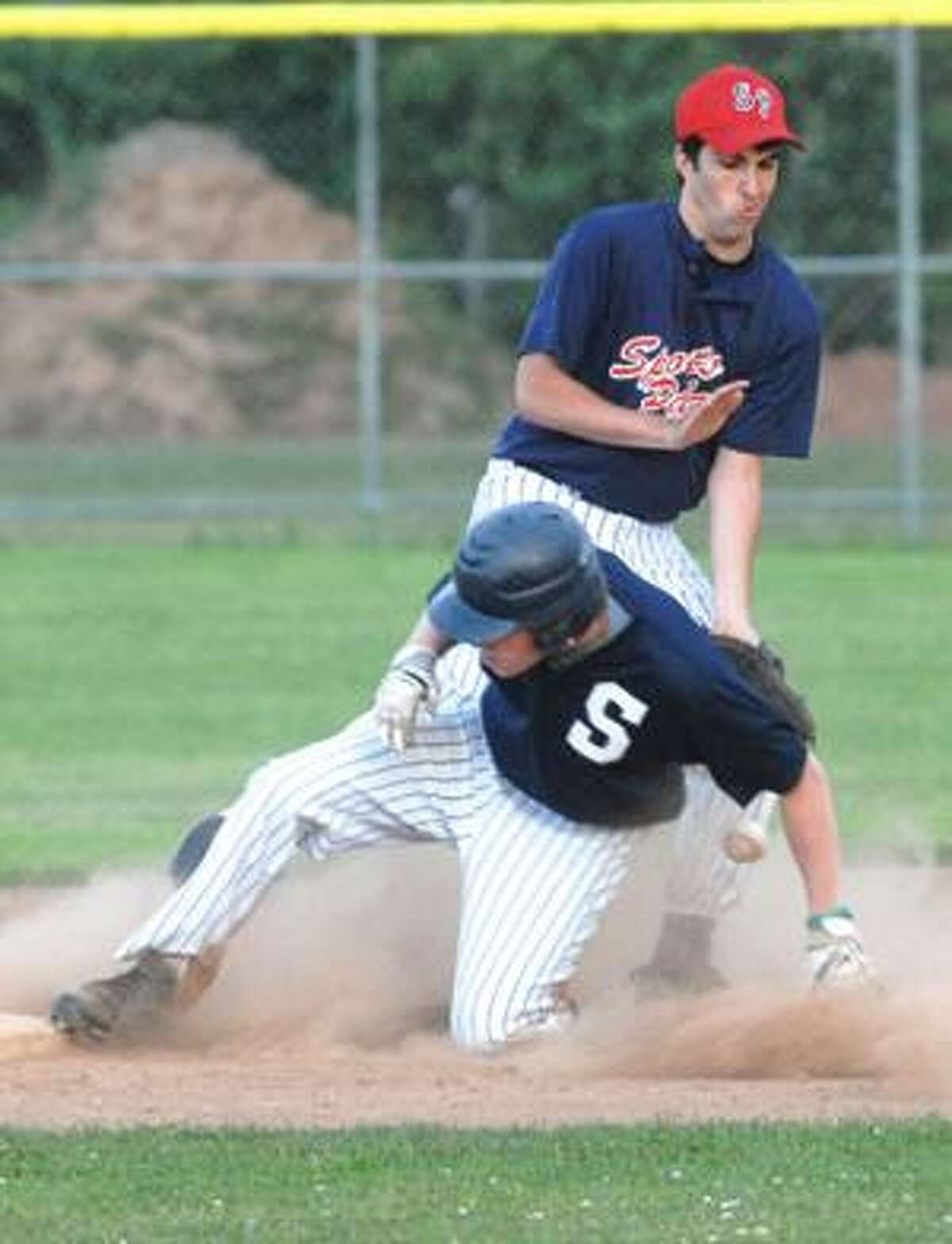 MIC NICOSIA/Register Citizen Washington's James McCluskey slides safely into second beneath Torrington's Jimmy Fuchsman during Wednesday's game at Fuessenich Park in Torrington. Torrington won 12-1. Purchase a glossy print of this photo and more at www.registercitizen.com.