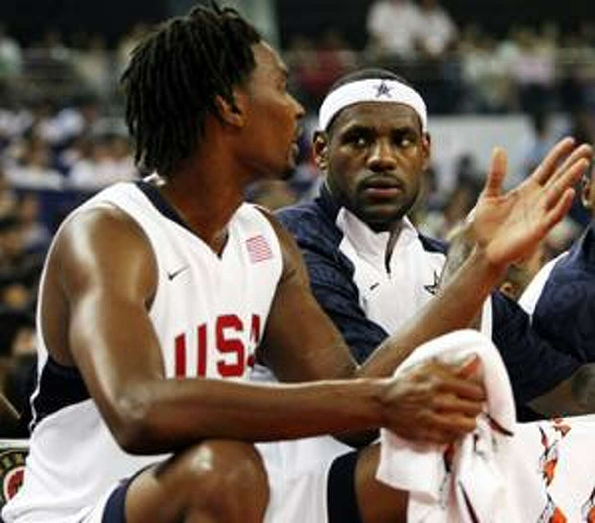 AP This Aug. 3, 2008, file photo shows Chris Bosh, left, and LeBron James, of the USA men's basketball team, chatting on the bench during a game between the USA and Russia in Shanghai. NBA free agency began today with James being the biggest prize of all.