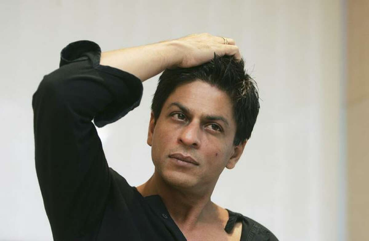 FILE - In this Dec. 8, 2008 file photograph, Bollywood actor Shah Rukh Khan gestures during an interview with The Associated Press at his residence in Mumbai, India. Khan was detained for questioning at Newark international airport and grilled for two hours before being let off by U.S. immigration authorities, a news agency report said Saturday. (AP Photo/Gautam Singh, File)
