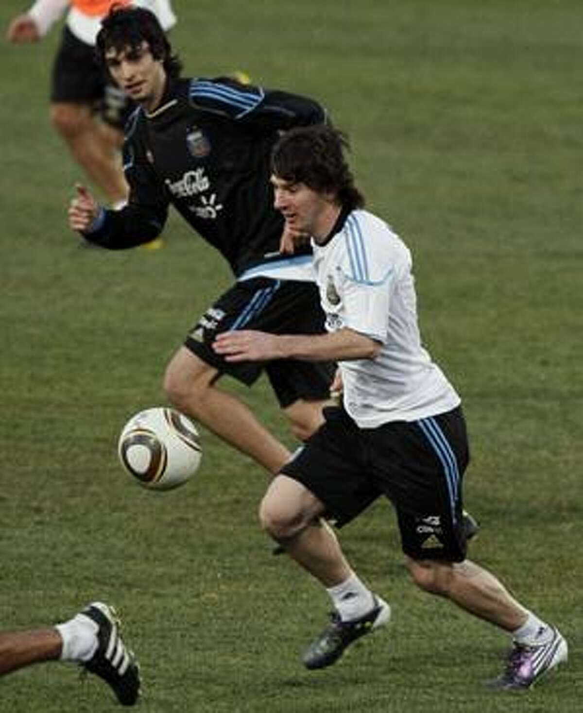 AP Argentina's Lionel Messi, right, runs with the ball during his team's practice in Pretoria, South Africa, Wednesday. Argentina will play Germany in a World Cup quarterfinal match on July 3.