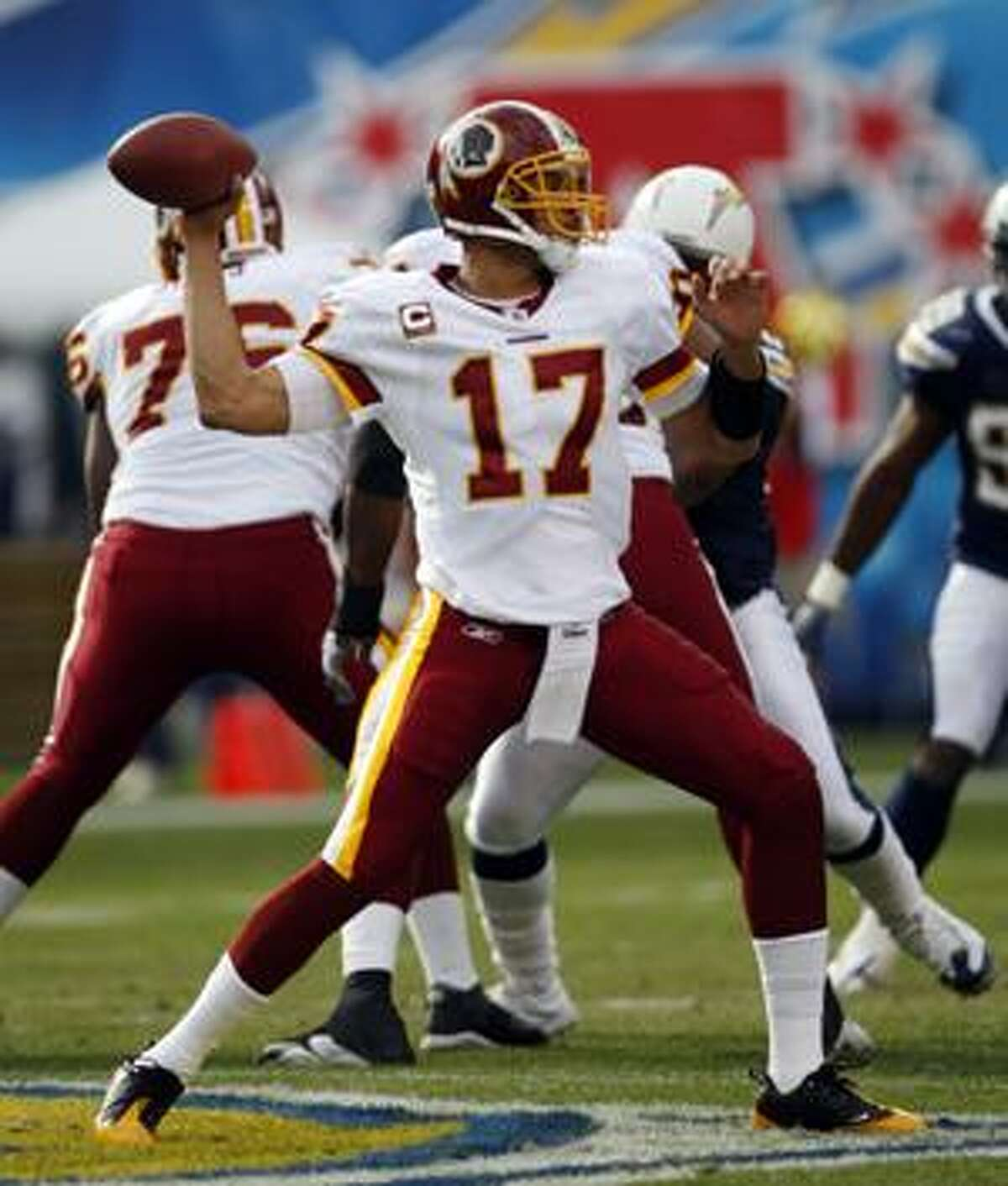 AP In this Jan. 3 file photo, Washington Redskins quarterback Jason Campbell throws a pass during the first quarter of a game against the San Diego Chargers in San Diego. The Oakland Raiders have acquired quarterback Jason Campbell from the Washington Redskins for an undisclosed future draft pick. The deal was announced at the NFL draft on Saturday.