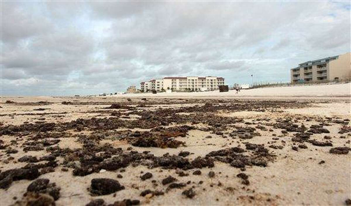 Tar balls and oily residue sits in patches and stains the sand in Orange Beach, Ala., Wednesday, June 30, 2010. Heavy seas from Tropical Storm Alex helped push more oil from the Deepwater Horizon disaster towards the Florida and Alabama coasts. (AP Photo/Dave Martin)