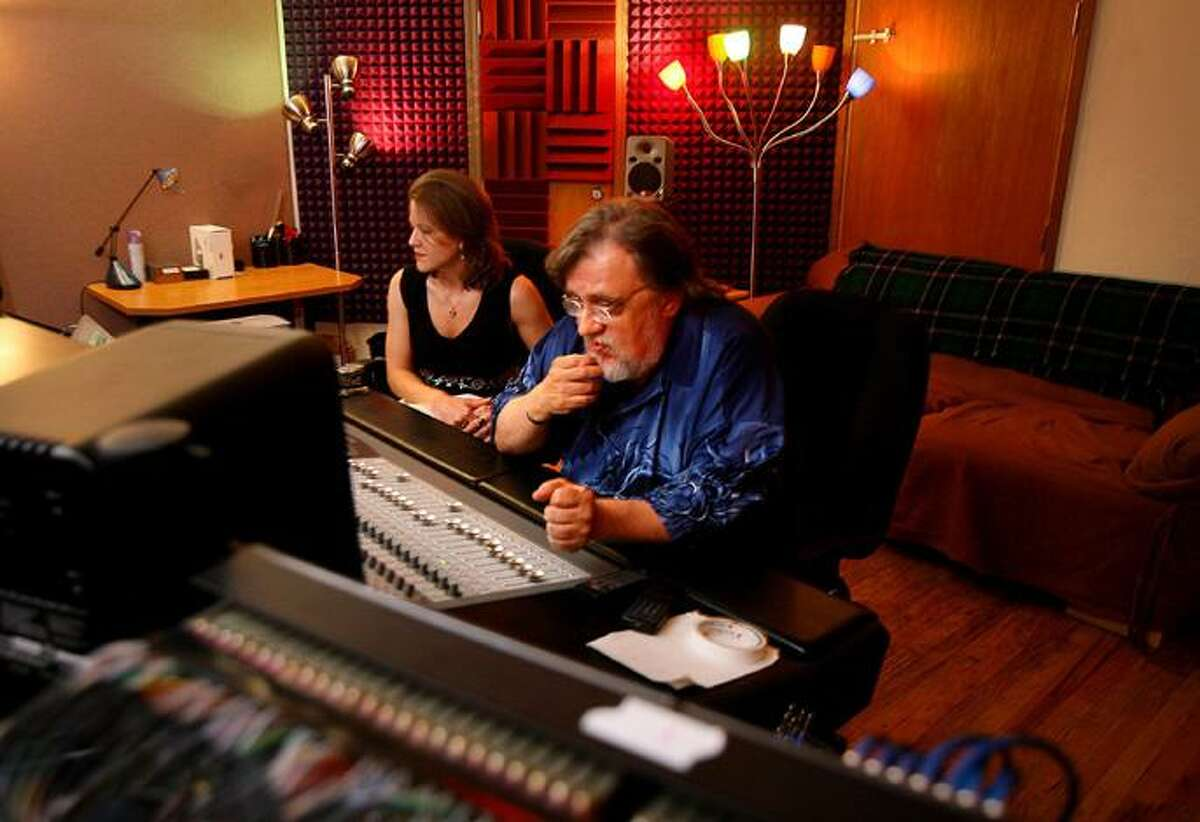 FILE - In this May 30, 2006 file photo, musician and producer Jim Dickinson listens to the new surround sound mixing console at Young Avenue Sound recording studio with engineer Jennifer Lee in Memphis, Tenn. Dickinson, a musician and producer who helped shape the Memphis sound in an influential career that spanned more than four decades, has died. He was 67. (AP Photo/The Commercial Appeal, Lance Murphey ) ** MEMPHIS OUT, MAGS OUT, TV OUT, ONLINE OUT, NO SALES **