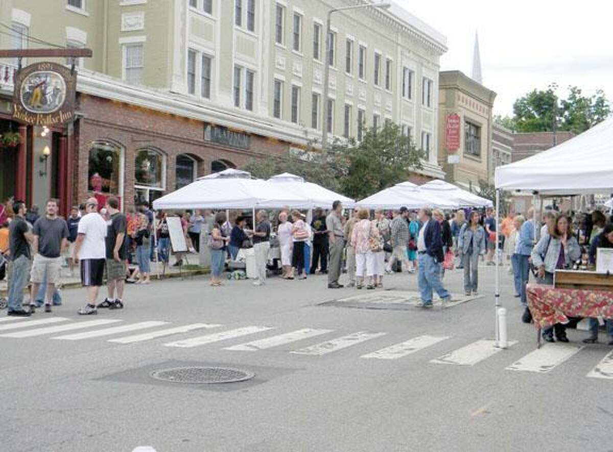 MIKE AGOGLIATI/ Register CitizenMore than 500 people turned out for the first Main Street Market Place held in dowtown Torrington.