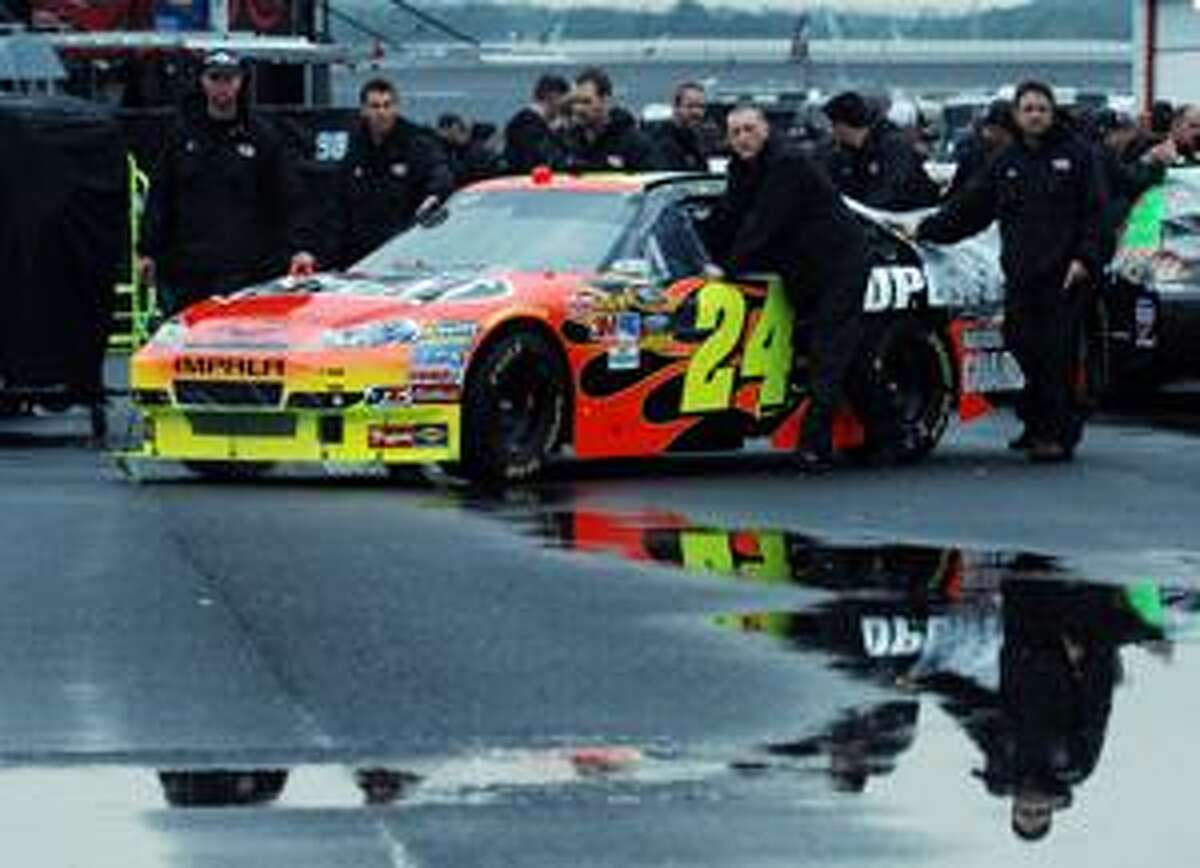 AP Jeff Gordon's crew puishes his car through the garage at Talladega Superspeedway in Talladega, Ala., Saturday. All NASCAR activity at Talladega was canceled due to the threat of severe weather.
