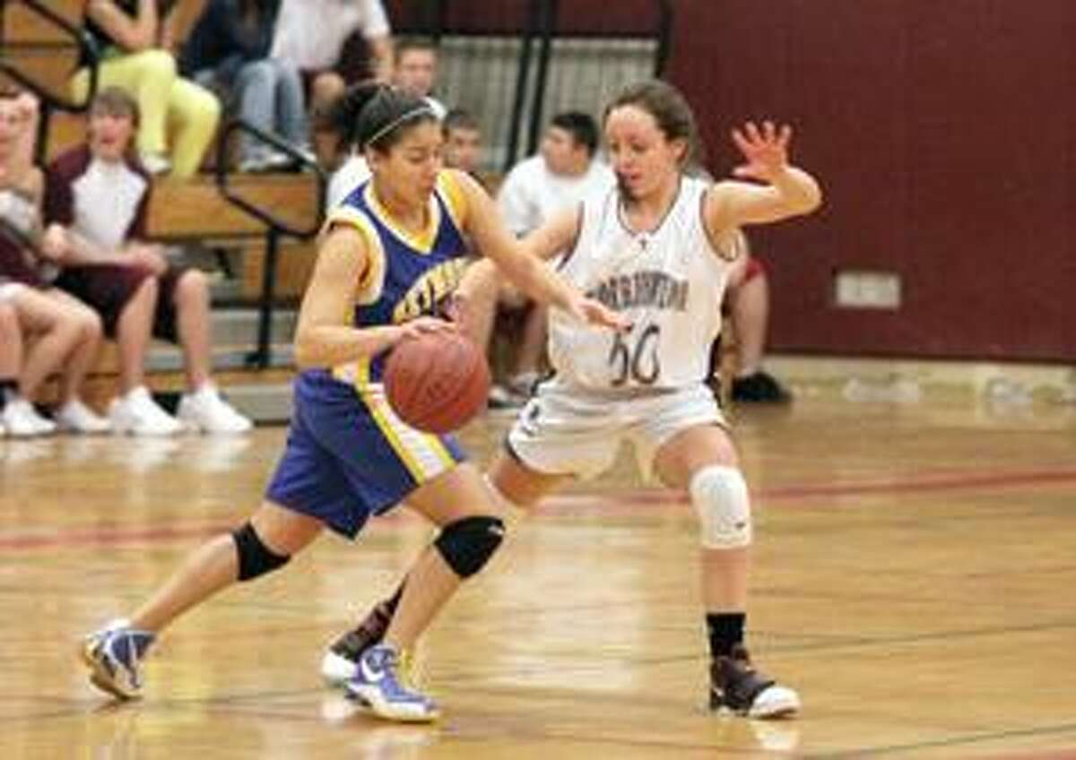 SONJA ZINKE/Register Citizen Seymour's Meghan Cabrera tries to dribble past Torrington's Mariah Cerruto during Friday night's game in Torrington. Purchase a glossy print of this photo and more at www.registercitizen.com.