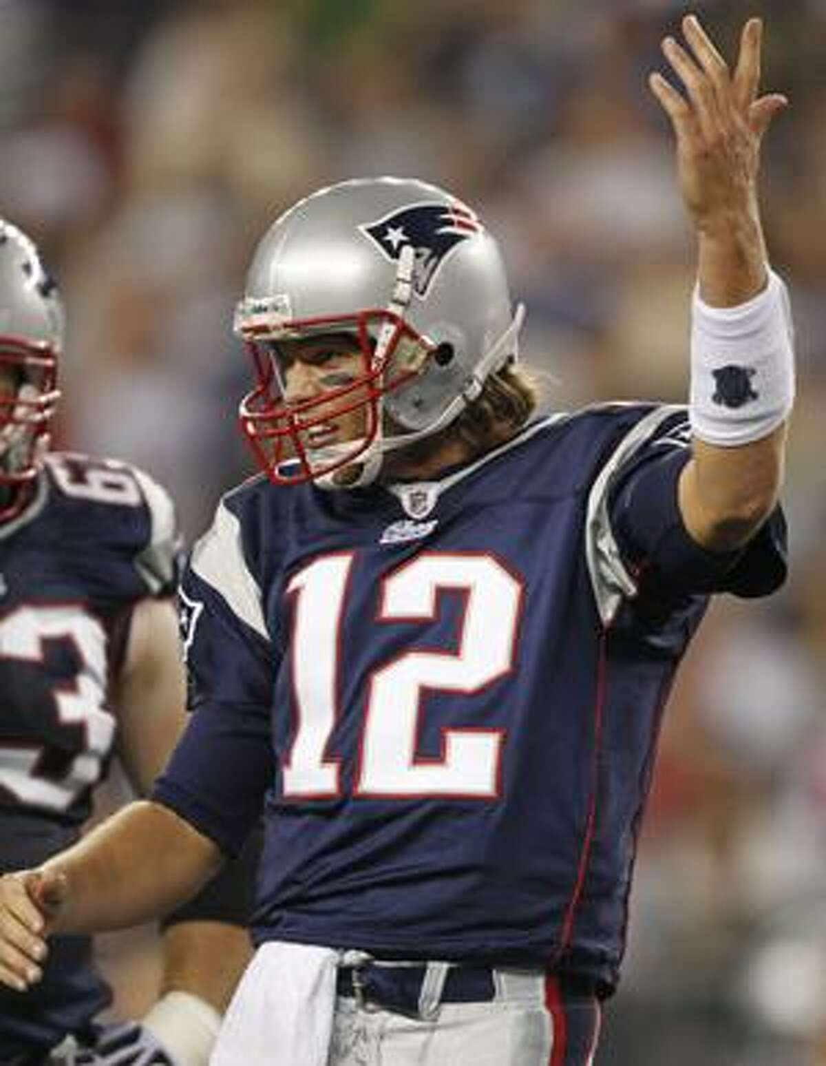 New England Patriots quarterback Tom Brady (12) protests a call in the first half of an NFL preseason football game against the St. Louis Rams on Thursday, Aug. 26, 2010, in Foxborough, Mass. (AP Photo/Michael Dwyer)