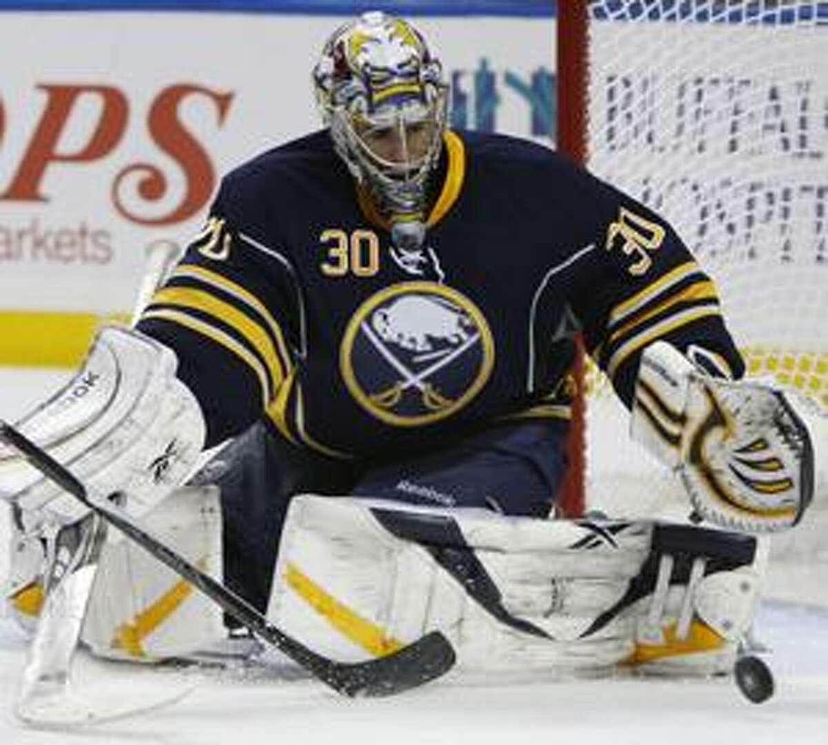 Buffalo Sabres goalie Ryan Miller makes a save against the Boston Bruins during the second period of a first-round NHL playoff hockey game in Buffalo, N.Y., Friday, April 23, 2010. (AP Photo/ David Duprey)