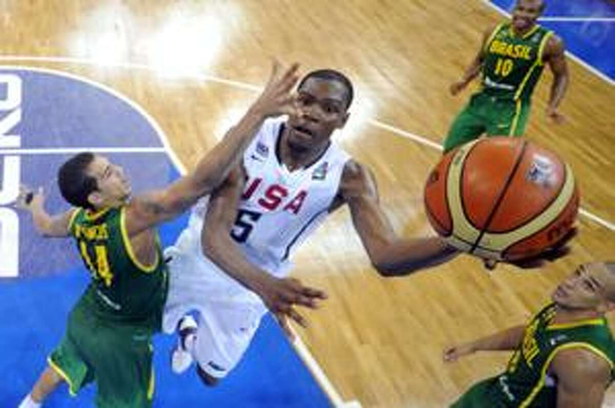 USA's Kevin Durant, right, puts up a shot as Brazil's Marcus Vieira defends during the preliminary round of the World Basketball Championship, Monday, Aug. 30, 2010, in Istanbul, Turkey. (AP Photo/Mark J. Terrill)