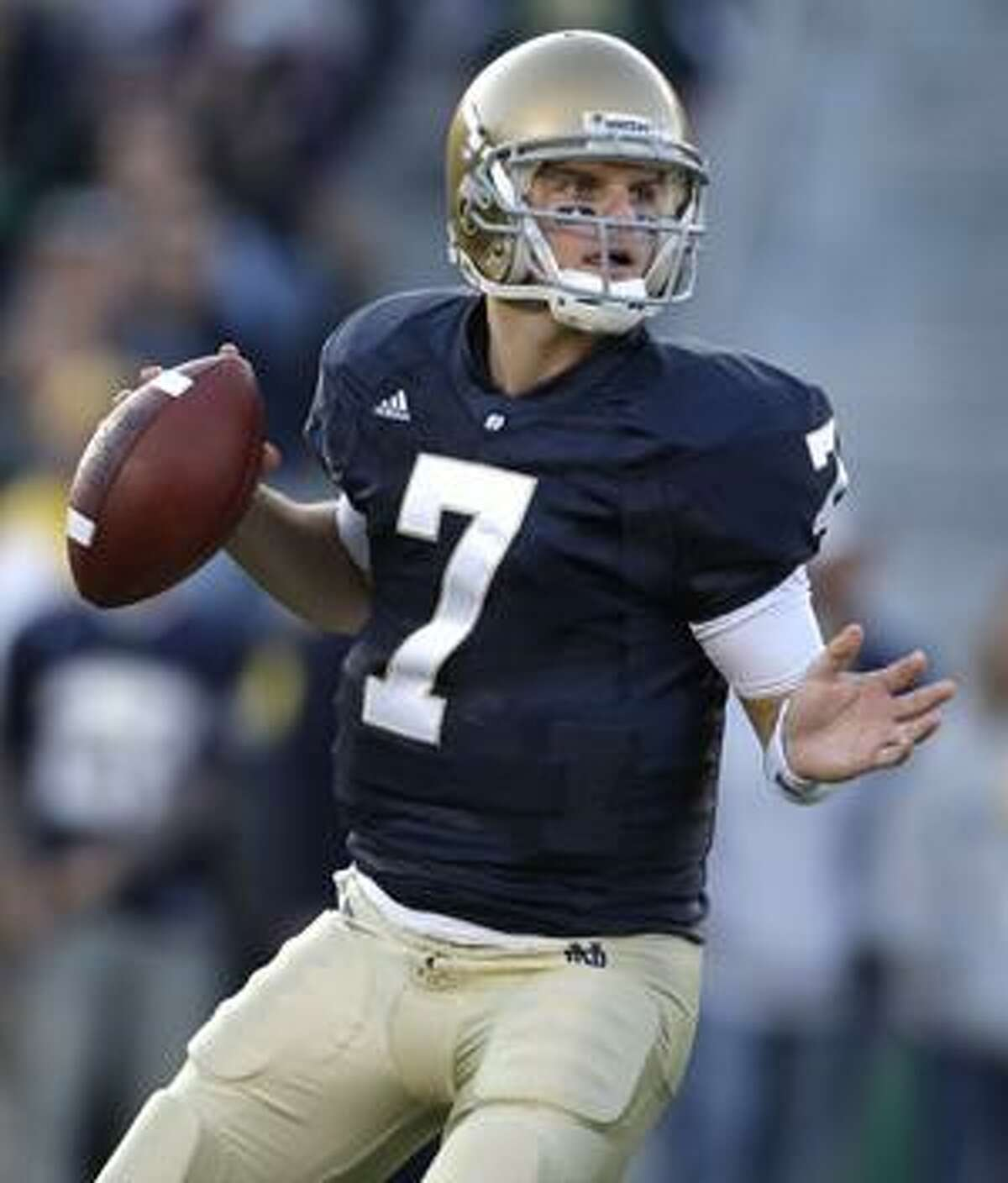 FILE - In this Nov. 7, 2009, file photo, Notre Dame quarterback Jimmy Clausen (7) looks to pass during the third quarter of an NCAA college football game in South Bend, Ind. Clausen was picked by the Carolina Panthers. (AP Photo/Darron Cummings, File)