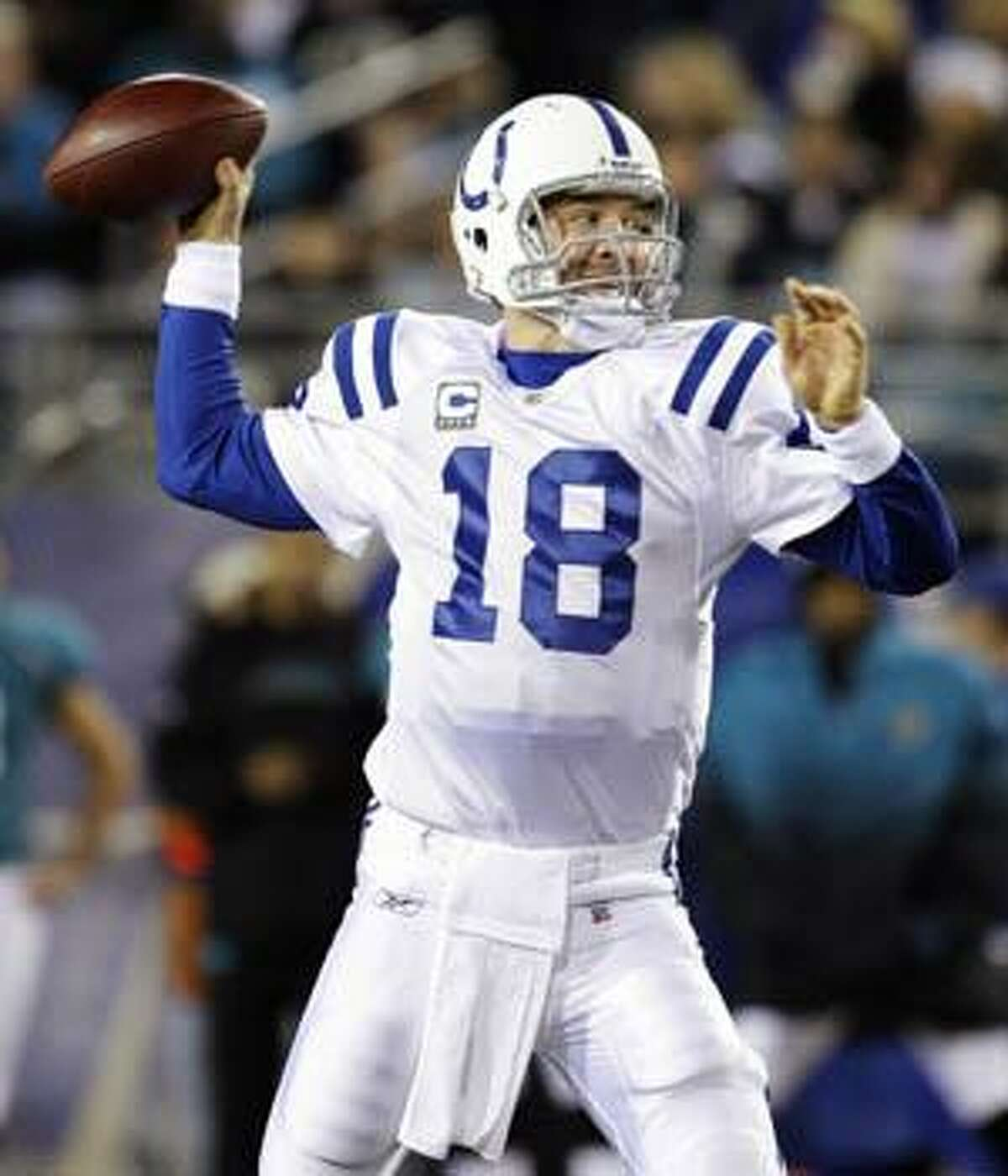 AP Indianapolis Colts quarterback Peyton Manning (18) throws a pass against the Jacksonville Jaguars during a game Thursday in Jacksonville, Fla. The Colts won 35-31 to remain unbeaten.