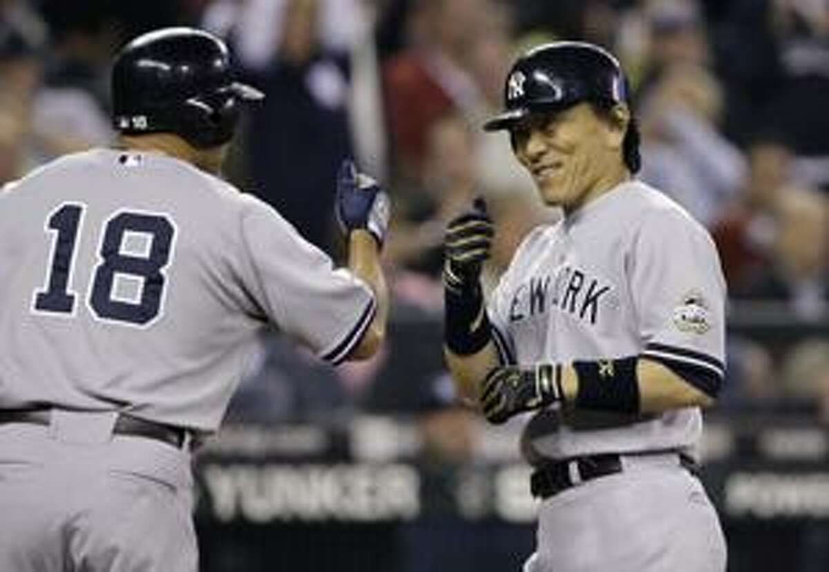 AP New York Yankees' Hideki Matsui, right, is greeted by Johnny Damon after Matsui's two-run home run against the Seattle Mariners in the third inning Thursday in Seattle.