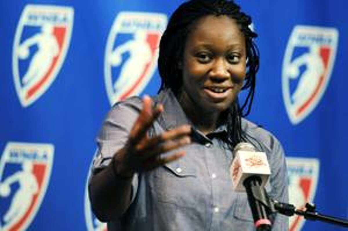Connecticut Sun's Tina Charles addresses the media after she was presented with the WNBA Rookie of the Year award during a news conference on Tuesday at Mohegan Sun Casino in Uncasville. Charles led the league in rebounding with 398, breaking the league season record in the process. Charles also broke the league record for double-doubles in a season with 22. (AP Photo/The Hartford Courant, Michael McAndrews)