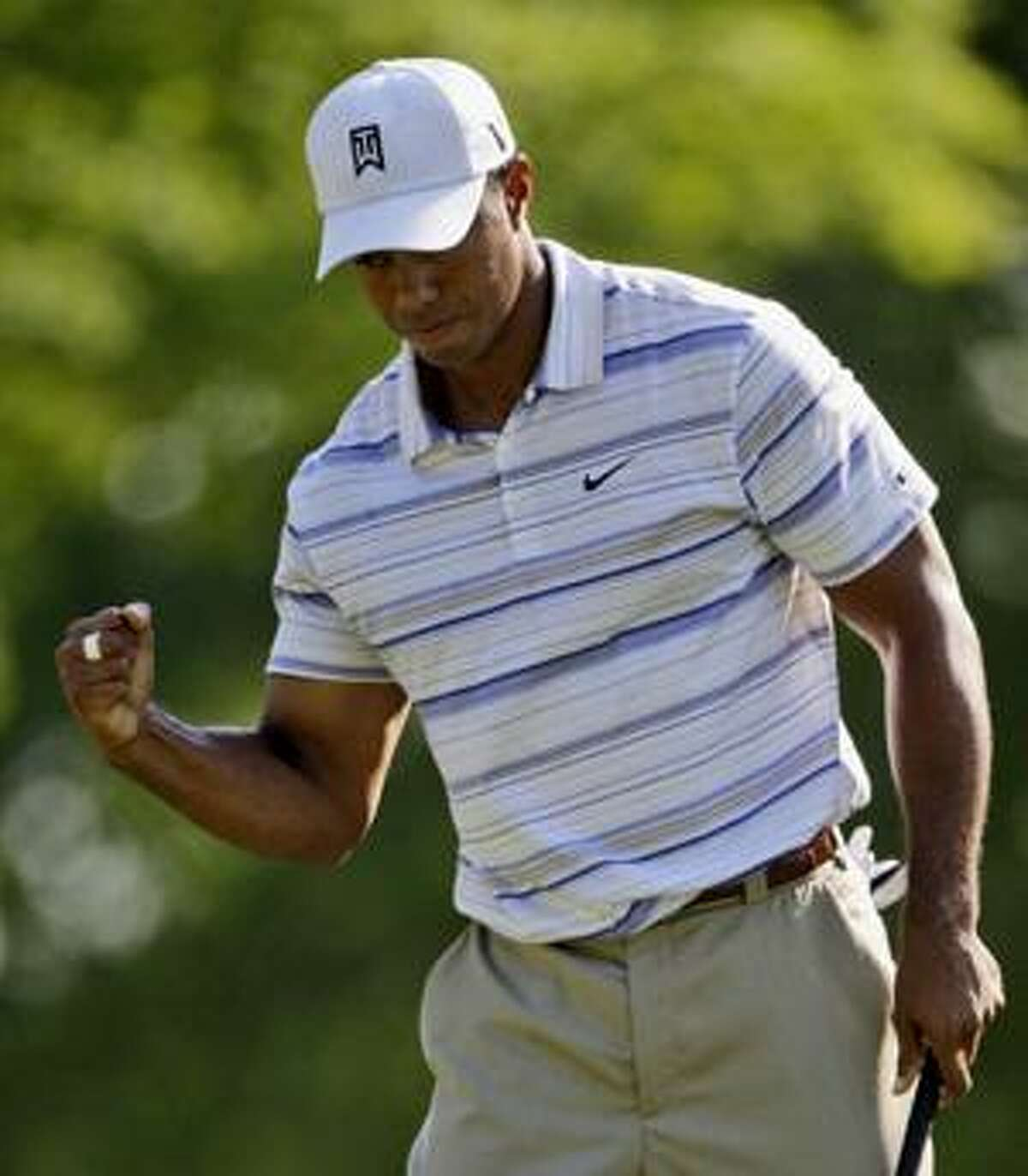 AP Tiger Woods pumps his fist after making par on the 12th hole during the second round of the 91st PGA Championship at the Hazeltine National Golf Club in Chaska, Minn., Friday.