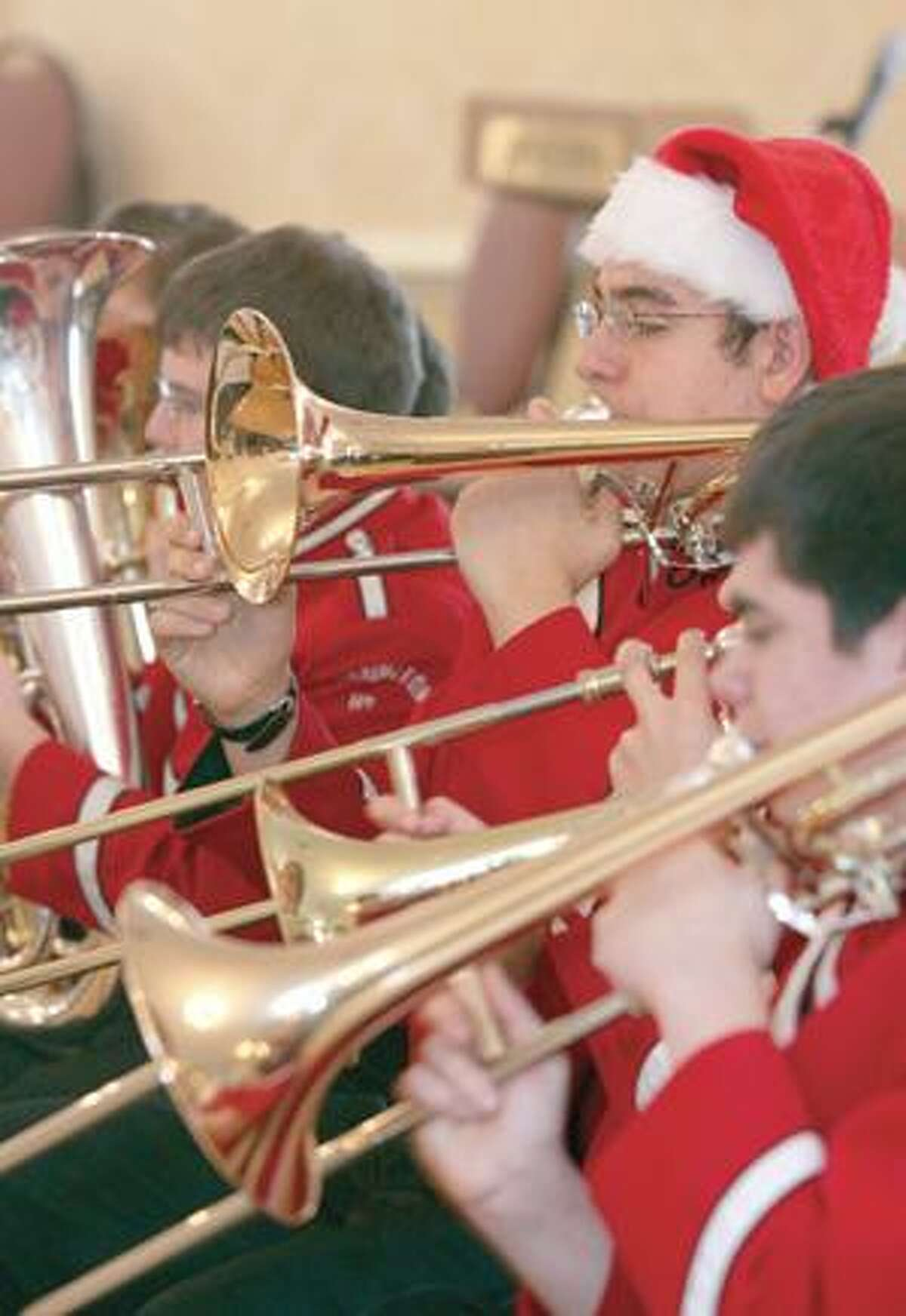 Bill Cornish Jr. of the Torrington High School Band performs Christmas songs for the seniors gathered at the Cornucopia in Torrington for the Edward E. Sullivan Senior Center holiday party Wednesday afternoon.