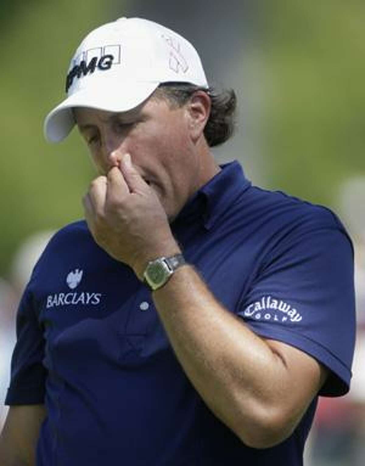 AP Phil Mickelson reacts after missing a birdie putt on the fourth hole during the second round of the 91st PGA Championship at the Hazeltine National Golf Club in Chaska, Minn., Friday.