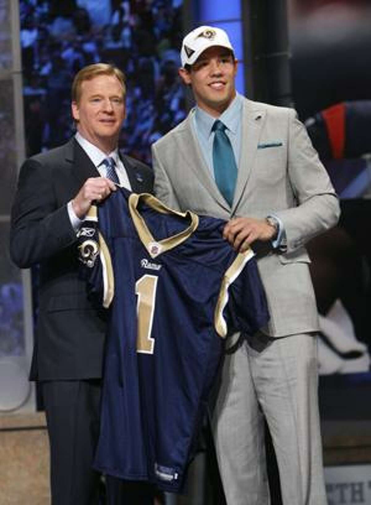 Oklahoma quarterback Sam Bradford, right, holds up a jersey with NFL commissioner Roger Goodell after he was selected as the No. 1 overall pick in the first round of the NFL Draft by the St. Louis Rams Thursday, April 22, 2010, at Radio City Music Hall in New York. (AP Photo/Jason DeCrow)