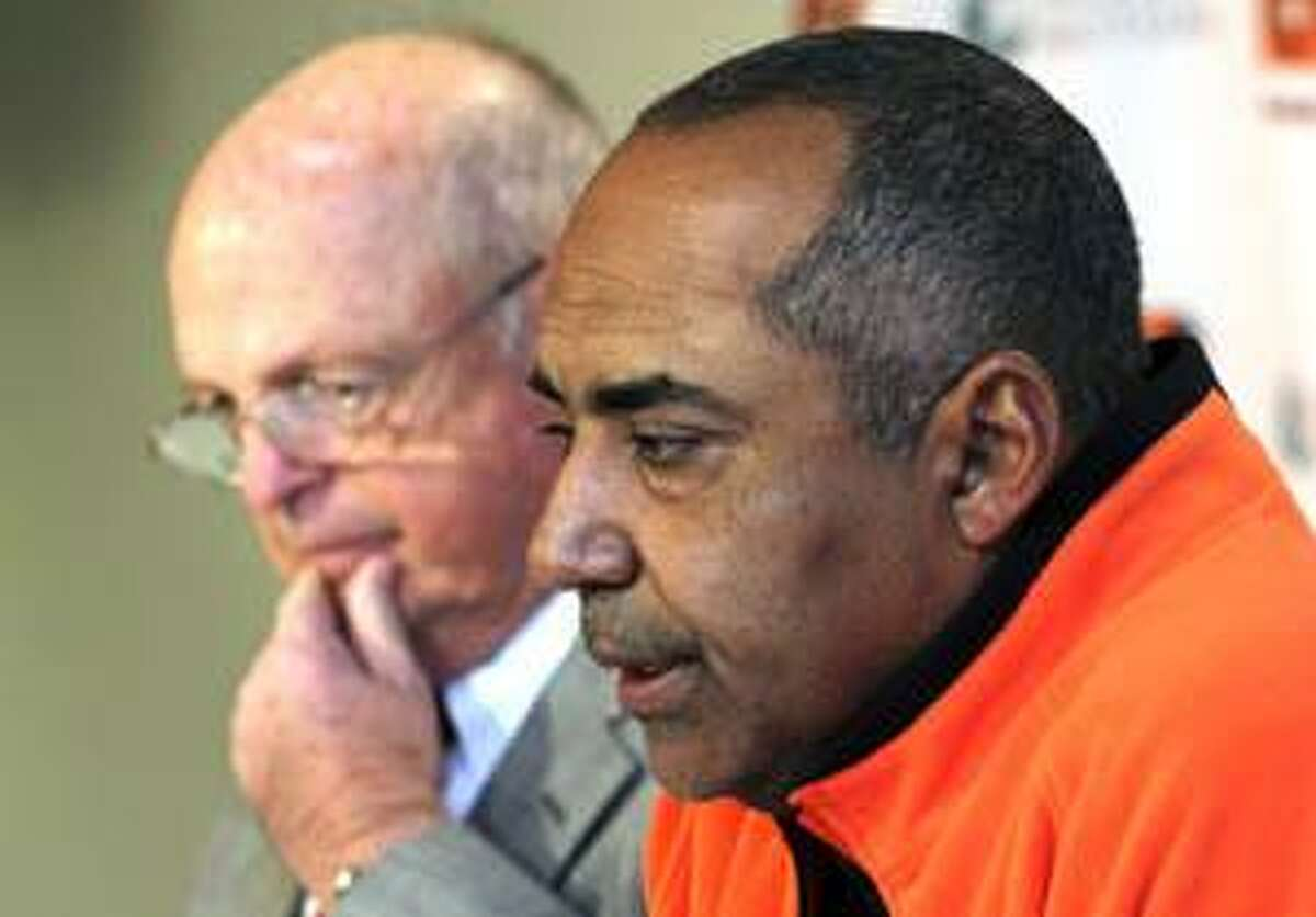 AP Cincinnati Bengals head coach Marvin Lewis, right, and team owner Mike Brown talk about the death of player Chris Henry during a news conference at Paul Brown Stadium in Cincinnati, on Thursday. Henry died Thursday, a day after falling out of the back of a pickup truck during what police said was a domestic dispute with his fiancee.