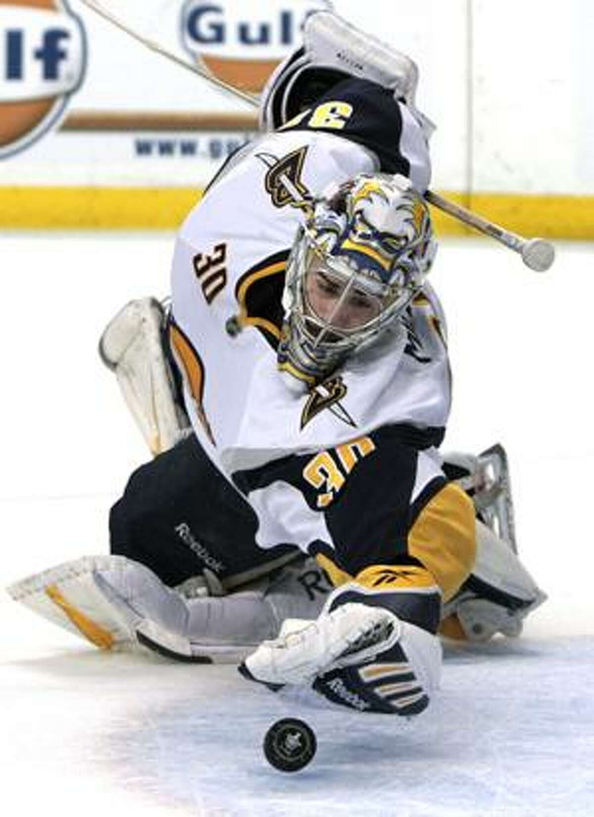 Buffalo Sabres goalie Ryan Miller (30) makes a glove save against the Boston Bruins during the first overtime period of Game 4 of an NHL hockey playoff series in Boston on Wednesday, April 21, 2010. (AP Photo/Elise Amendola)