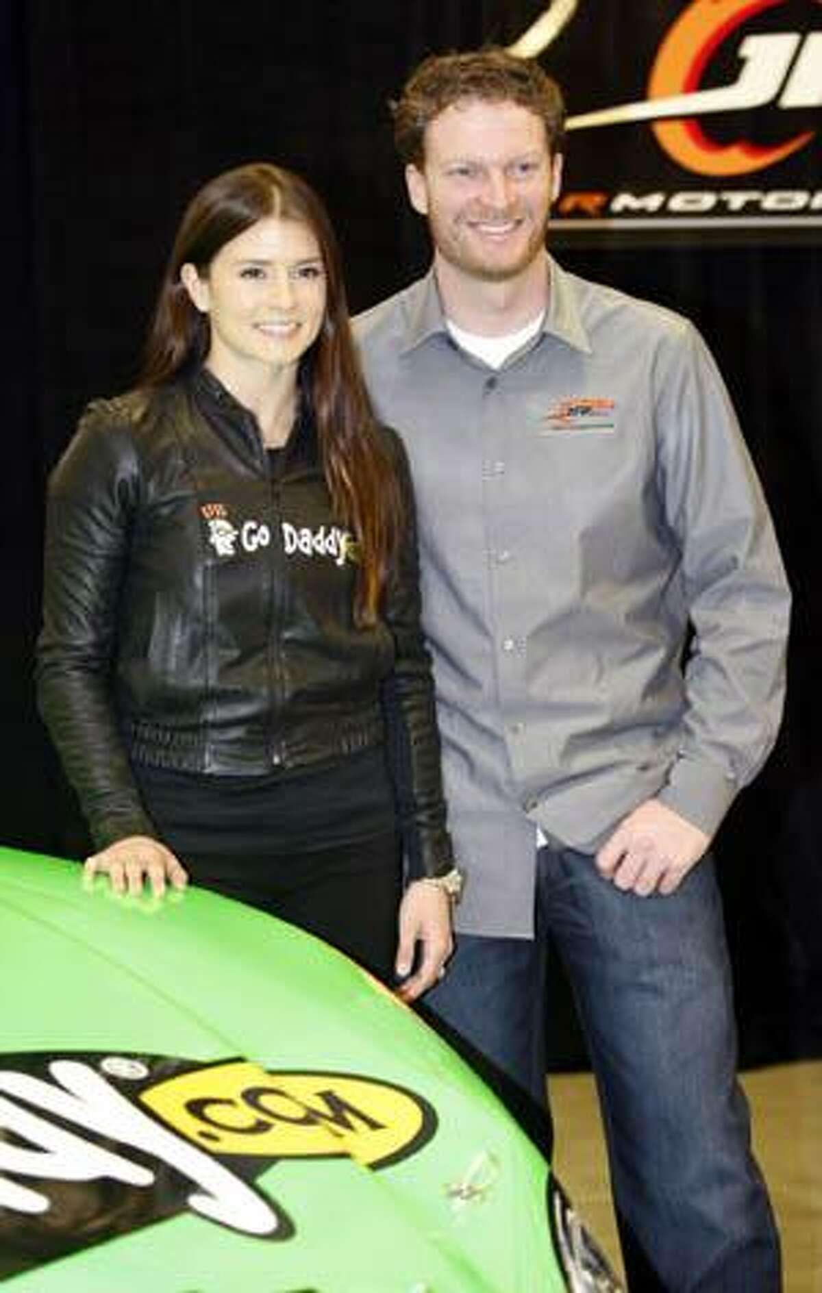 AP Danica Patrick, left, poses with team co-owner Dale Earnhardt during a news conference to discuss Patrick's plans to race for JR Motorsports, in Mooresville, N.C. on Thursday.