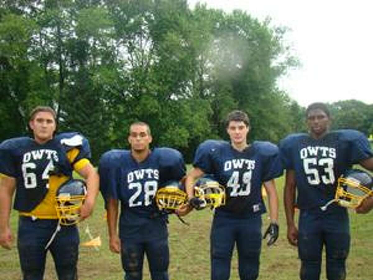 TIMOTHY W. GAFFNEY/Register Citizen Correspondent Four of the six Wolcott Tech players who have been with football program since it started four years ago are shown above. They are: David Sullivan, Isaiah Harrington, Patrick Higgins, Trevor Carlson Not Pictured: Matt Archer and Sebastian Walsh.
