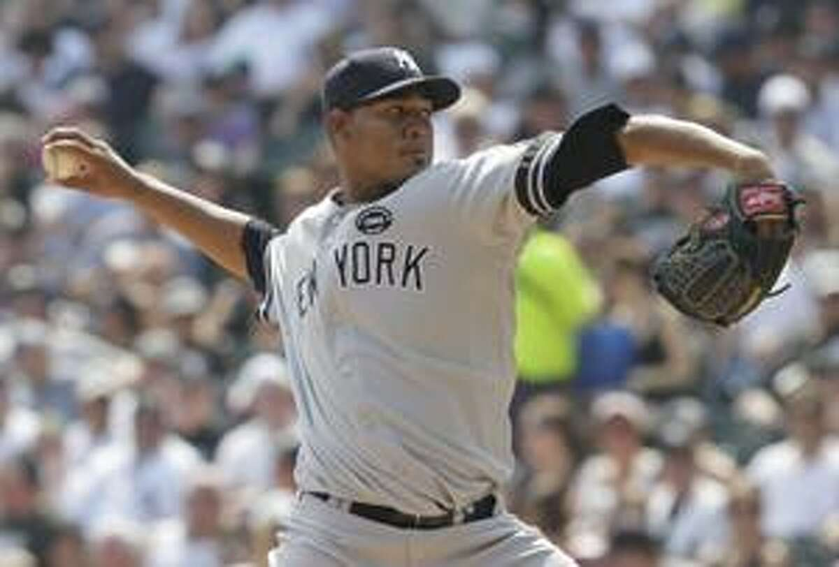 AP New York Yankees starter Ivan Nova delivers a pitch against the Chicago White Sox during the third inning of Sunday's game in Chicago. Nova picked up his first major league win as the Yankees beat the White Sox 2-1.