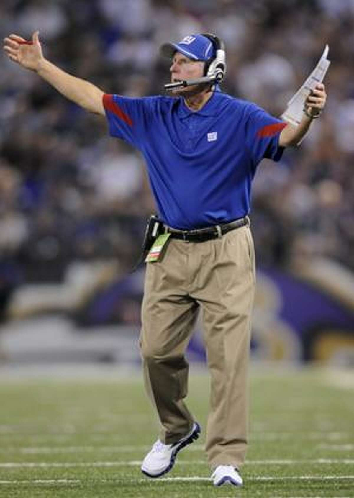 AP New York Giants head coach Tom Coughlin questions an official's call during the first half of a preseason game against the Baltimore Ravens, Saturday, in Baltimore.
