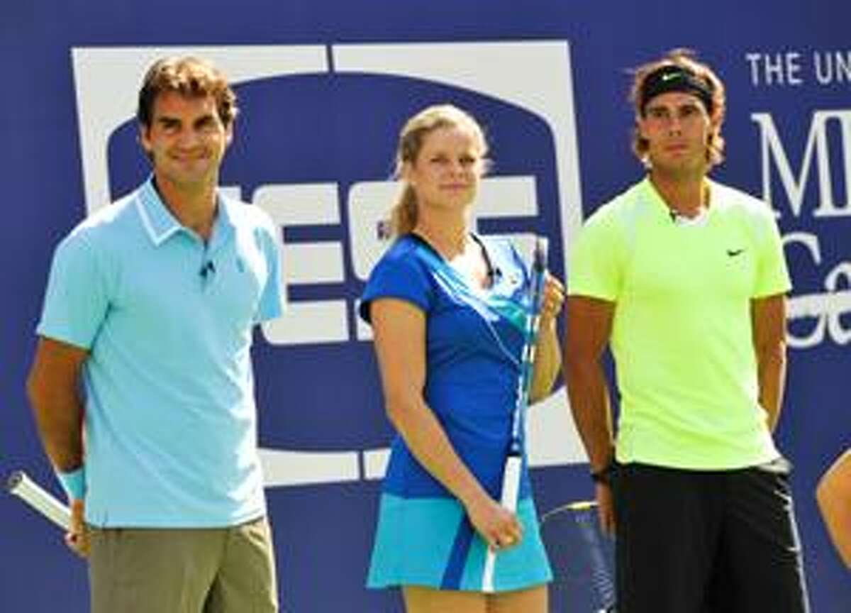AP Tennis players, from left, Roger Federer, Kim Clijsters and Rafael Nadal participate in Arthur Ashe Kids Day at the USTA Billie Jean King National Tennis Center on Saturday in New York.